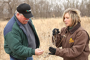 Pheasants Forever Farm Bill biologist Kelsi Wehrman and landowner Mark Ohmstede discuss a Farm Bill conservation project along the Republican River in Nebraska. Photo courtesy of Larry Kruckenberg.